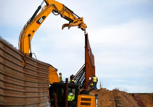 (AP Photo/Gregory Bull). Workers replace sections of the border wall, left, with new sections, right, Tuesday, Jan. 8, 2019, in Tijuana, Mexico. Ready to make his case on prime-time TV, President Donald Trump is stressing humanitarian as well as securi...