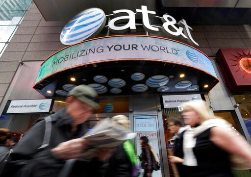 (AP Photo/Richard Drew, file). In this Oct. 21, 2014 file photo, people pass an AT&T store in New York's Times Square. AT&T says it will stop selling customer location data to data brokers, as the telecom industry faces backlash that the data h...