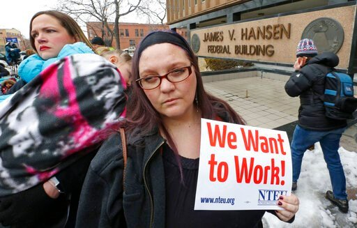 (AP Photo/Rick Bowmer). IRS worker Christine Helquist joins a federal workers protest rally outside the Federal Building, Thursday, Jan., 10, 2019, in Ogden, Utah. Payday will come Friday without any checks for about 800,000 federal employees affected ...