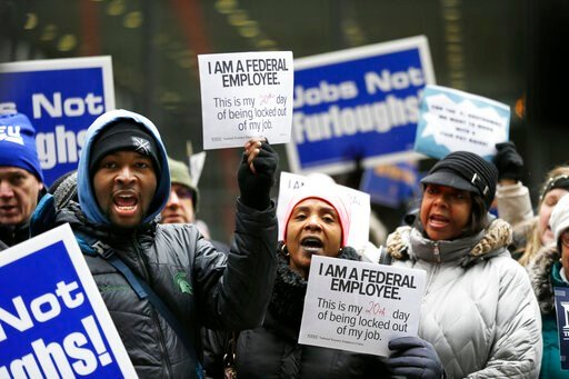 (AP Photo/Kiichiro Sato). Government workers rally against the partial government shutdown at Federal Plaza, Thursday, Jan. 10, 2019, in Chicago. The partial government shutdown continues to drag on with hundreds of thousands of federal workers off the...