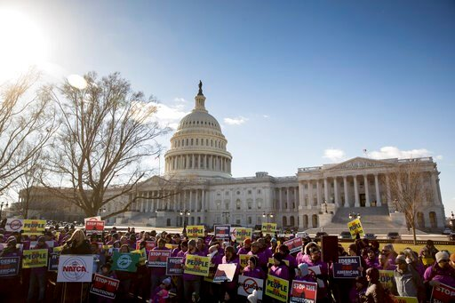 (AP Photo/Andrew Harnik). Union members protest the government shutdown on Capitol Hill in Washington, Thursday, Jan. 10, 2019.