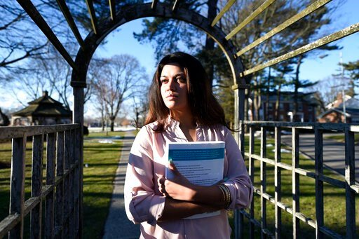 (AP Photo/Kathy Kmonicek). FILE - In this Feb. 2, 2016, file photo, Naila Amin, 26, holds a book from one of the classes she was taking at Nassau Community College in Garden City, N.Y. According to data provided to The Associated Press, the U.S. approv...