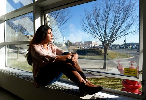 (AP Photo/Kathy Kmonicek). FILE - In this Feb. 2, 2016, file photo, Naila Amin, 26, looks out from a classroom window at Nassau Community College in Garden City, N.Y. According to data provided to The Associated Press, the U.S. approved thousands of re...