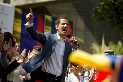 (AP Photo/Fernando Llano). Juan Guaido, President of the Venezuelan National Assembly delivers a speech during a public session with opposition members, at a street in Caracas, Venezuela, Friday, Jan. 11, 2019. The head of Venezuela's opposition-run co...