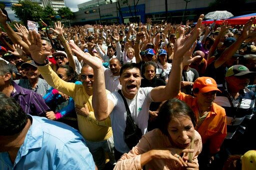 """(AP Photo/Fernando Llano). Opposition members shout """"Guaido President"""" during public a session of National Assembly at a street in Caracas, Venezuela, Friday, Jan. 11, 2019. Juan Guaido, the head of Venezuela's opposition-run congress says that with th..."""