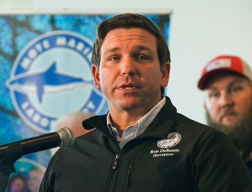 (Dan Wagner/Sarasota Herald-Tribune via AP, File). FILE - In this Jan. 10, 2019 file photo, Republican Gov. Ron DeSantis announces funding for his environmental policy during a press conference at Mote Marine Laboratory in Sarasota, Fla. DeSantis and t...
