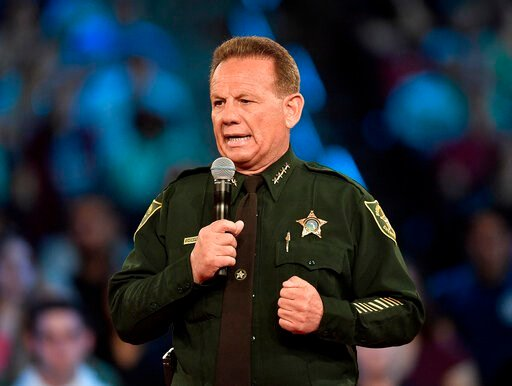 (Michael Laughlin/South Florida Sun-Sentinel via AP, File). FILE - This Feb. 21, 2018 file photo, shows Broward County Sheriff Scott Israel speaking before a CNN town hall broadcast, at the BB&T Center, in Sunrise, Fla. New Florida Gov. Ron DeSanti...