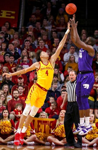 (AP Photo/Justin Hayworth). Iowa State forward George Conditt IV tries to block the shot of Kansas State forward Makol Mawien during the first half of an NCAA college basketball game, Saturday, Jan. 12, 2019, in Ames, Iowa.