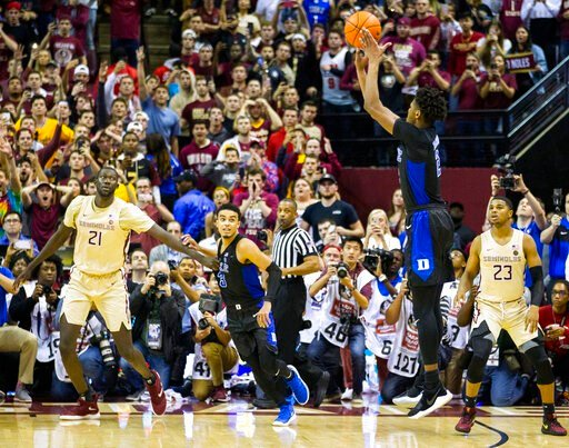 (AP Photo/Mark Wallheiser). Duke forward Cam Reddish takes the game-winning shot against Florida State with less than a second left in an NCAA college basketball game in Tallahassee, Fla., Saturday, Jan. 12, 2019. Duke defeated Florida State 80-78.
