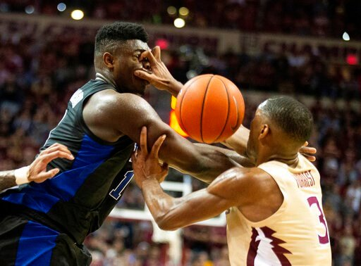 (AP Photo/Mark Wallheiser). Florida State guard Trent Forrest, right, gets his hand in the face of Duke forward Zion Williamson forcing a turnover in the first half of an NCAA college basketball game in Tallahassee, Fla., Saturday, Jan. 12, 2019.