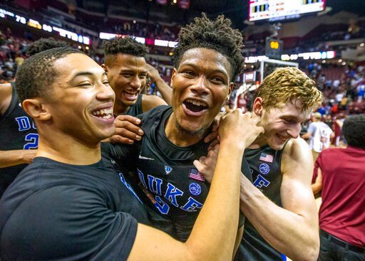(AP Photo/Mark Wallheiser). Duke guard Jordan Goldwire, left, and forward Jack White, right, celebrate with Cam Reddish after Reddish scored the game-winning jump shot against Florida State with less than a second left in the second half of an NCAA col...