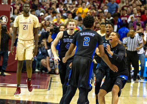 (AP Photo/Mark Wallheiser). Duke guard Jordan Goldwire, right, forward RJ Barrett, center, and forward Jack White rush the court to celebrate with Cam Reddish after Reddish scored the game-winning jump shot against Florida State with less than a second...